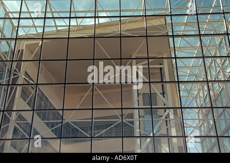 A very close view of a leaning glass facade on a building exhibiting modern architecture in Utah, USA. - Stock Photo