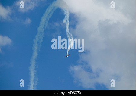 colourful acrobatic aeroplane in the sky - Stock Photo