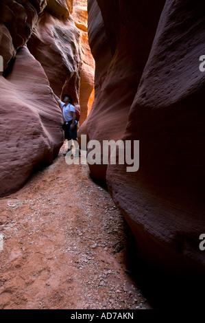 Hiker in sandstone Slot Canyon at Buckskin Gulch Paria Canyon Vermilion Cliffs Wilderness Utah - Stock Photo