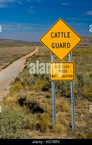 Bicycle Warning sign next to dirt road through high desert plateau Grand Canyon Parashant National Monument Arizona - Stock Photo