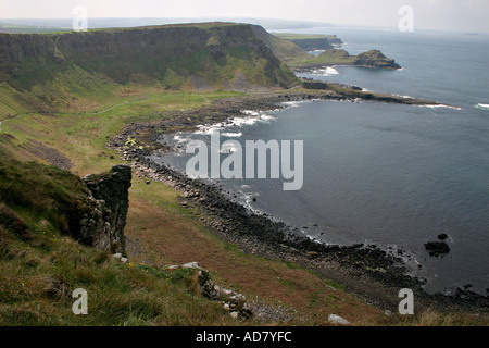 The view from the Causeway Coast Way path of the inlet and headland to the east of the causeway itself Tiny  walkers - Stock Photo