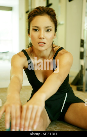 Young woman at the gym - Stock Photo