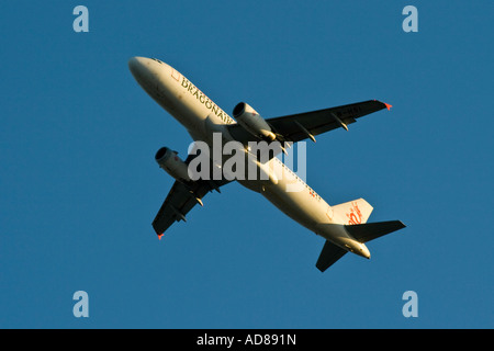 Dragonair Airline Airbus A320 Airplane in Flight just after Takeoff - Stock Photo