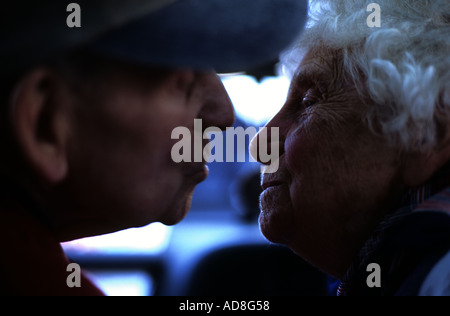 Elderly couple kissing in their car - Stock Photo