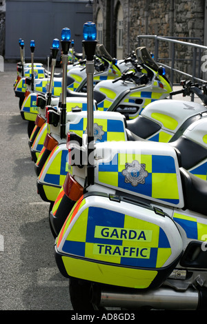 A row of bright green and blue traffic motorbikes each with a blue lamp parked along a street near Dublin Castle - Stock Photo