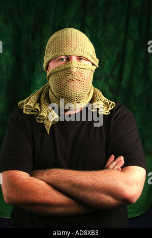 hidden identity scrim and folded arms dsca 4247 - Stock Photo