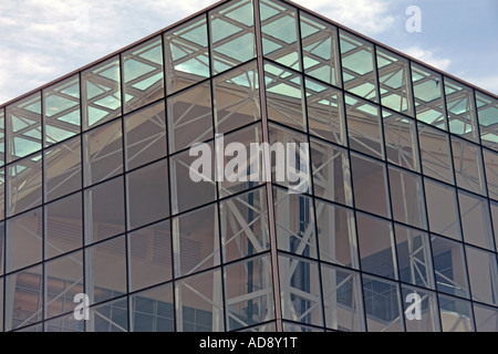 A close view of a leaning glass facade on a building exhibiting modern architecture in Utah, USA. - Stock Photo