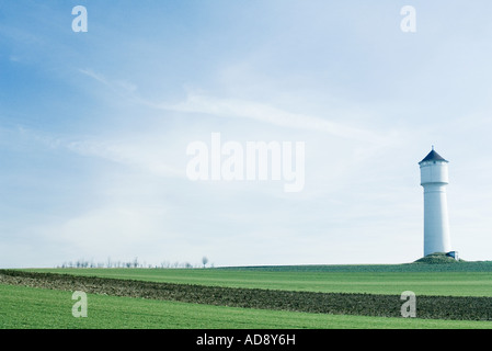 Tower in green field - Stock Photo
