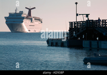 A large cruise ship sits anchored offshore near the island of Catalina off the coast of southern California. - Stock Photo
