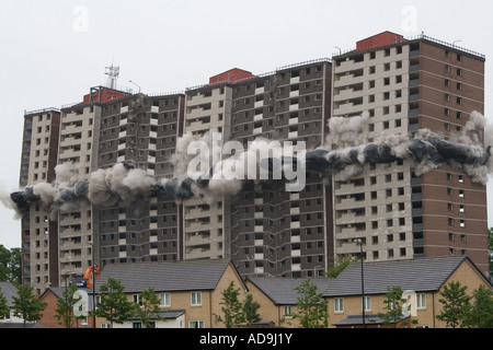 Clouds of dust engulf Ardler village after controlled explosions demolishing the last multi-storey building in Dundee, - Stock Photo