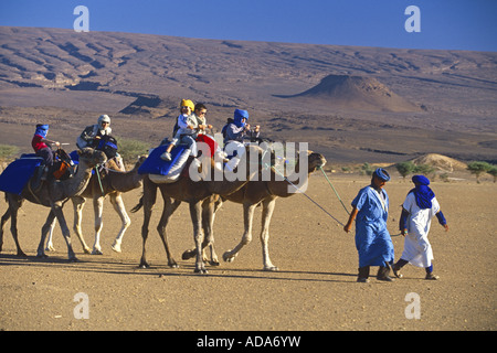 tourists on a camel trip in South Marokk, Morocco - Stock Photo