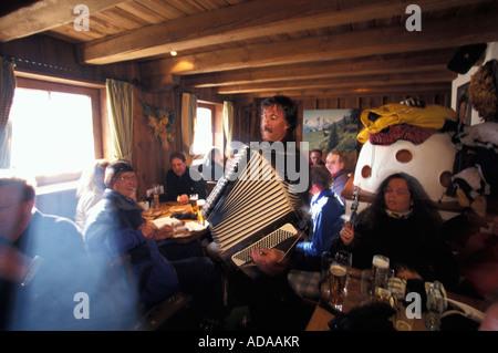 Traditionel accordion music in the Gampe Alp Restaurant Hut Otztal Tyrol Austria - Stock Photo