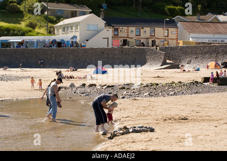 Wales Carmarthenshire Carmarthen Pendine people crossing stream on beach - Stock Photo