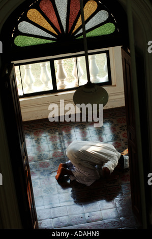 Galle Fort a moslem praying in the Meeran Jumma Masjid mosque - Stock Photo