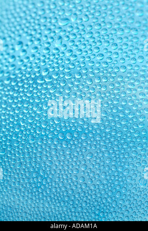 Air Bubbles & Dew Drops On Blue Water Bottle - Stock Photo