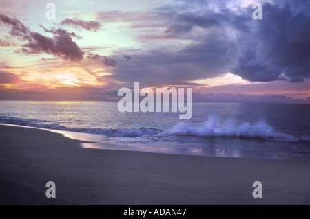 Waves Splashing On Beach At Sunset, Polihale State Beach Park, Barking Sands Beach, Kauai, Hawaii USA - Stock Photo