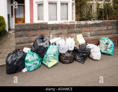 Rubbish bags awaiting collection on a residential street Cardiff Wales UK - Stock Photo