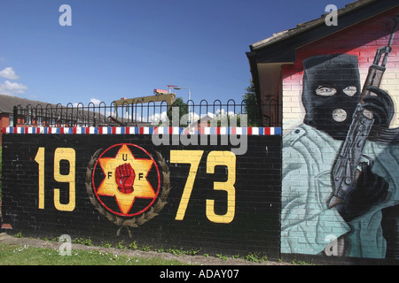 Loyalist mural of hooded paramilitary with gun in East Belfast - Stock Photo