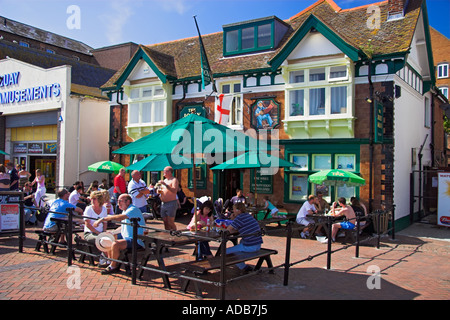 People drinking outside the Jolly Sailor public house Poole Dorset England - Stock Photo