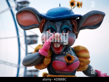 Fun mouse inviting for a ride on the roller coaster at the Octoberfest in Munich Bavaria Germany - Stock Photo