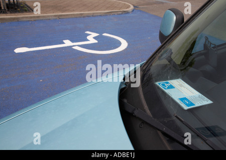 car with eu northern ireland issued parking card for people with disabilities parked in disabled parking bays in - Stock Photo