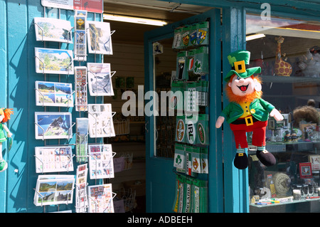postcards stickers and soft toy leprechaun hanging outside tourist souvenir shop in avoca county wicklow - Stock Photo