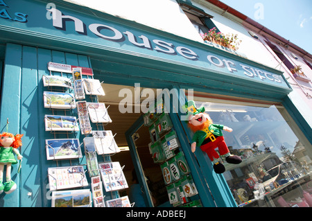 postcards stickers and soft toy leprechaun hanging outside tourist house of gifts souvenir shop in avoca county - Stock Photo