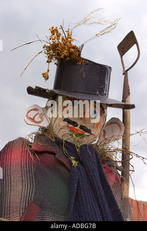 Gardener Scarecrow holding hoe.  'Bus Stop' at summer Hinderwell Summer Gala. waiting for transport, fund raising - Stock Photo