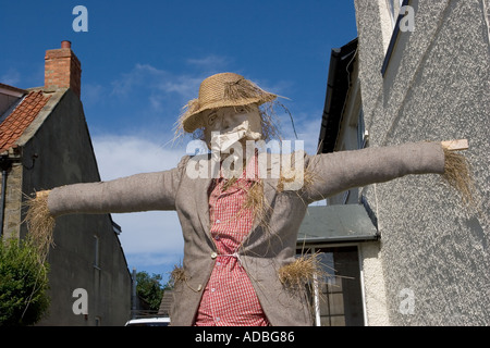 Straw Scarecrow at the Scarecrow Festival, Hinderwell, Yorkshire Valley, North Yorkshire, Northern England, UK - Stock Photo