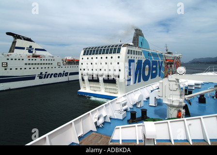 Olbia Sardina port arrival of Moby Lines Aki ferry covered in graphics depicting cartoon characters - Stock Photo