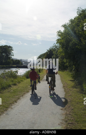 dh Corpach CALEDONIAN CANAL INVERNESSSHIRE Two  bike cyclist man  boy cycling on tow path cyclists leisure uk canals - Stock Photo