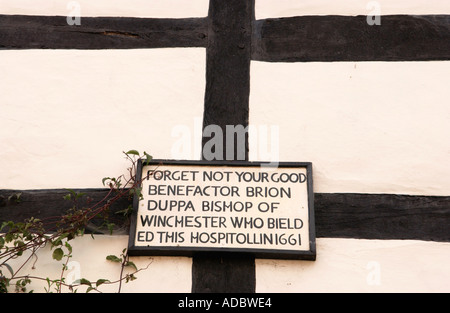 Sign on Duppa Cottages former almshouses dating from the post medieval period 16th century Pembridge Herefordshire - Stock Photo