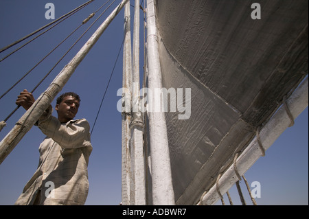 Crew member on a Felucca boat on the Nile River in Aswan, Egypt - Stock Photo