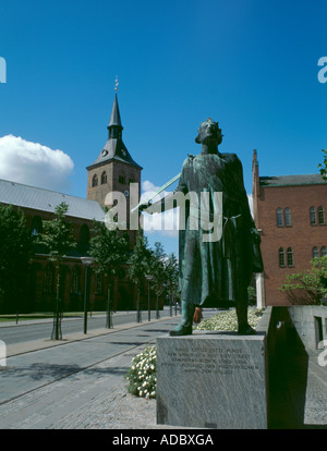 Statue of St Knud ( King Knud II, king of Denmark ) with Skt Knuds Domkirke ( Cathedral ) beyond, Odense, Fyn (Funen), - Stock Photo