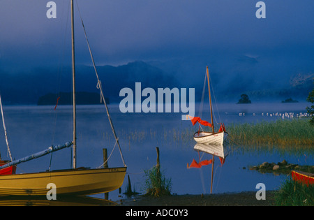 boats on Derwentwater nr Keswick at dawn Lake District Cumbria England UK - Stock Photo
