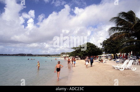 Sainte Anne part of the sandy beach with palm tree and holidaymakers at seaside resort tropical - Stock Photo