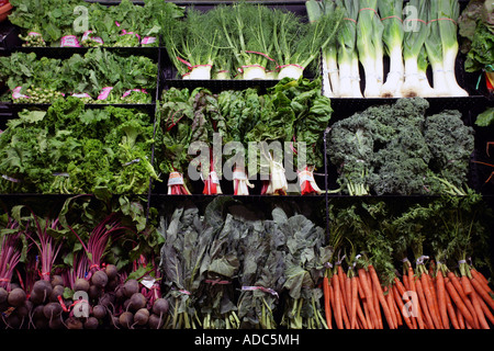 Organic Foods in a supermarket display case. Healthy eating health foods. Greens