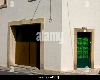 an angular detailed view of two doors in old french village house in the south of france - Stock Photo
