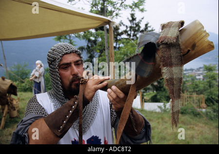 A horn blower during the traditional historic evoking of the Middle Ages in Sale Marasino, Italy - Stock Photo