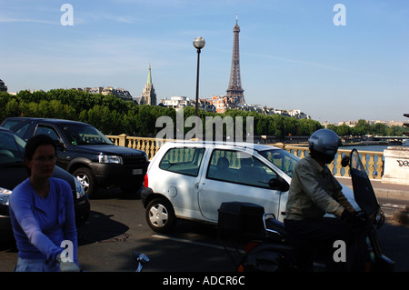 traffic in Paris with a clear view of the Eiffel Tower on a bright sunny summer day - Stock Photo