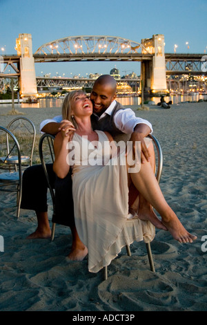 Interracial love story of a black man and a white woman Model released - Stock Photo