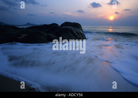 Waves washing on to beach of Ko Samui island Thailand - Stock Photo