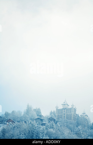 Switzerland, Vaud canton, Lavaux region, snowy mountain landscape with castle - Stock Photo