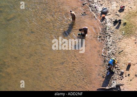 Bird's Eye View Of Women Washing Clothes In Nam Ou River - Stock Photo