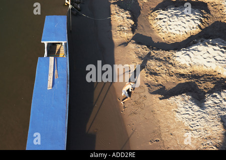 Bird's Eye View Of Boy Playing In Sand - Stock Photo