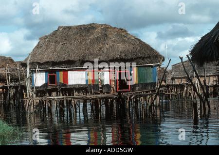 African bamboo hut built on stilts in fishing village on Lake Nokoue near Cotoneau Benin Africa - Stock Photo