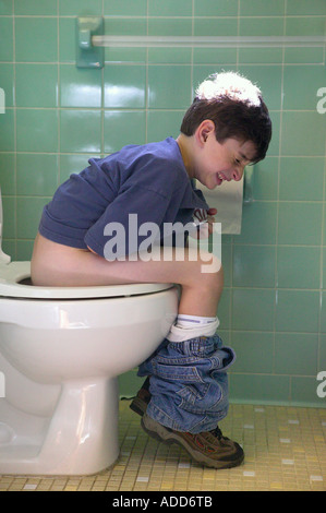 Little Boy Sitting On The Toilet Stock Photo Royalty Free
