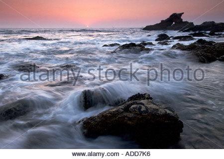 Low Tide and Sea Stack at Dusk Corona Del Mar California - Stock Photo