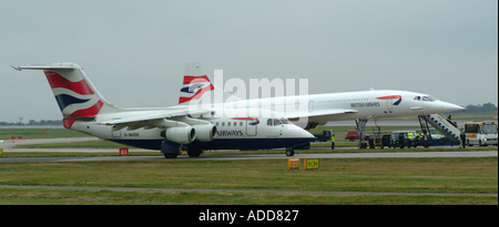 BAe 146 Passes Concorde During Farewell to Manchester 22 October 2003 England United Kngdom UK - Stock Photo