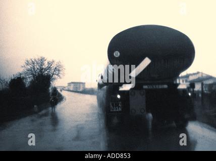 Vintage 1965 Italy lorry in rain - Stock Photo